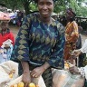 A woman vendor in Nigeria selling yellow maize (Photo: IITA)