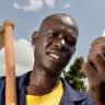 Eric Owandu receiving farming advice on his mobile phone