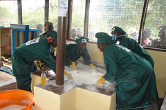 Women frying gari at Walihun cassava processing center