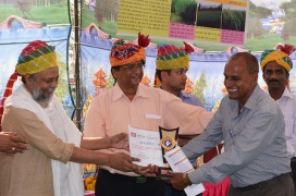 Mr Rajendra Singh (Left) and Dr KB Saxena giving away awards to farmers at the farmers' field day in Badua village.