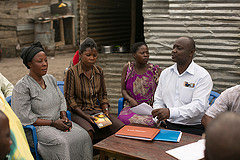 Kachanga village leaders in discussion with local fisheries officer (right), Uganda. Photo by Ryder Haske, 2013.