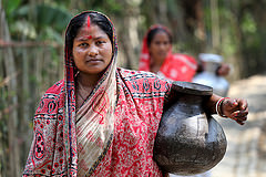 Women carrying drinking water in Fultola Village, Khulna, Bangladesh. Photo by M. Yousuf Tushar.