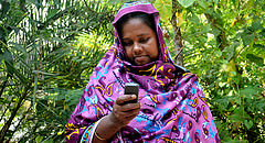 Woman farmer receiving mobile money on her phone, at USAID mSTAR workshop. Photo by Sayma Islam, Research Assistant, WorldFish